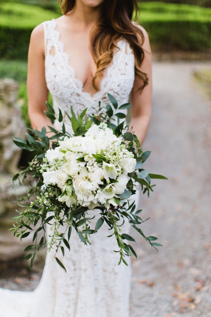 Bride's gown by Inbal Dror. Bouquet by Out of the Garden. Hair by Swish. Image by Clay Austin Photography at Magnolia Plantation & Gardens.