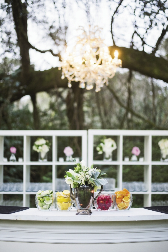 Bar service by Squeeze OnSite. Florals by Out of the Garden. Rentals by Ooh! Events. Image by Clay Austin Photography at Magnolia Plantation & Gardens.