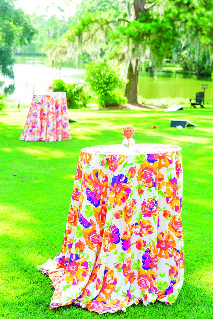 "Vibrantly patterned linens and boldly hued florals took over the cocktail hour. ""Remembering those tablecloths make me and my mom smile to this day,"" says Andra of BBJ Linen's ""Blumen Shantung."""