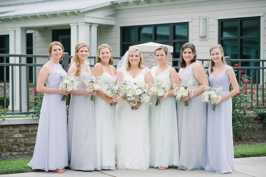Bride's gown by Maggie Sottero, available in Charleston through Bridals by Jodi. Bridesmaid gowns by Amsale from Bella Bridesmaids. Image by Aaron and Jillian Photography at Wild Dunes Resort.