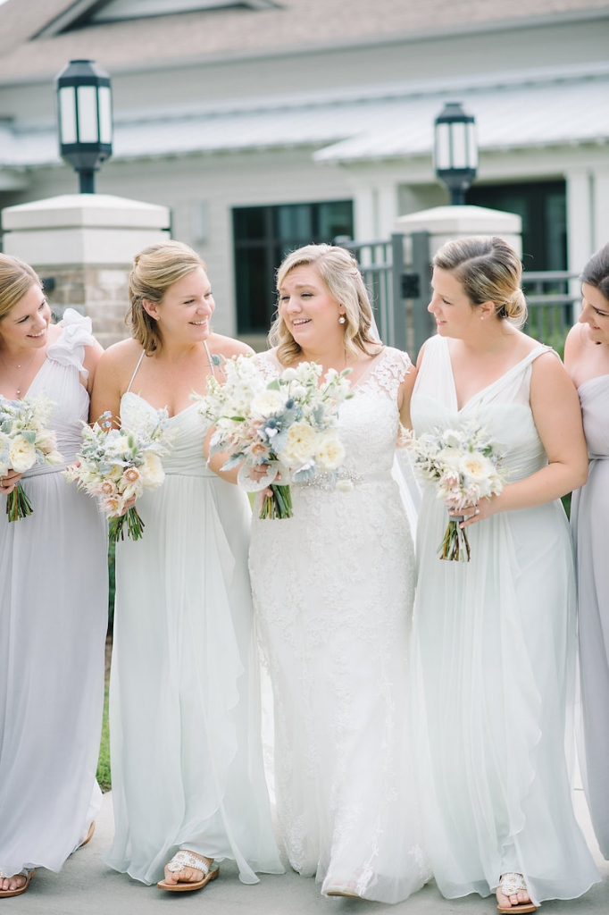 Bride's gown by Maggie Sottero, available in Charleston through Bridals by Jodi. Bridesmaid gowns by Amsale from Bella Bridesmaids. Florals by Branch Design Studio. Image by Aaron and Jillian Photography at Wild Dunes Resort.