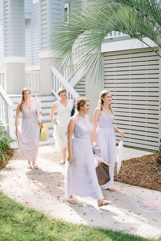 Bridesmaid gowns by Amsale from Bella Bridesmaids. Bride's gown by Maggie Sottero, available in Charleston through Bridals by Jodi. Image by Aaron and Jillian Photography at Wild Dunes Resort.
