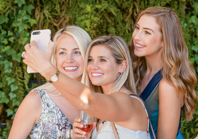 Jillian Attaway Eversole with friends snapping a selfie.