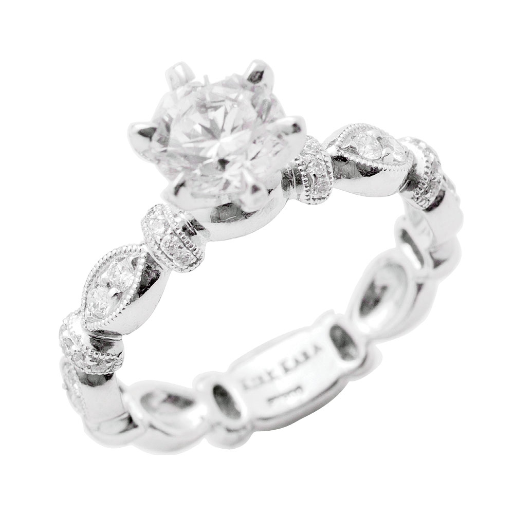 Dahlia Collection by Kirk Kara's platinum ring with accent diamonds (.23 total cts.; setting only) and matching band with diamonds (.26 total cts.), both from Diamonds Direct (prices upon request)