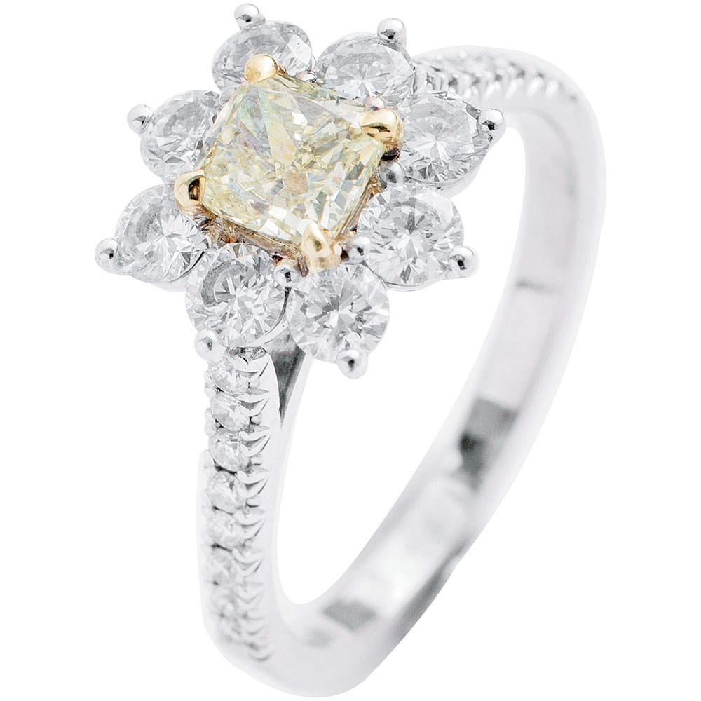 Forevermark's 18K white gold ring with yellow diamond center (.70 cts.) and accent diamonds (1.72 total cts.) from Paulo Geiss Jewelers ($7,500)