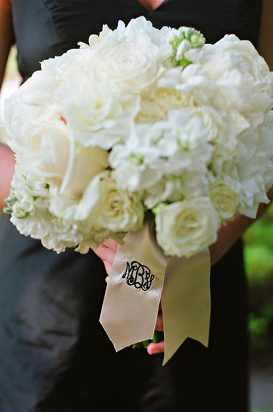 TRADITIONAL TONES: All-white bridesmaid bouquets popped against their full-length Jenny Yoo frocks from Bella Bridesmaid.