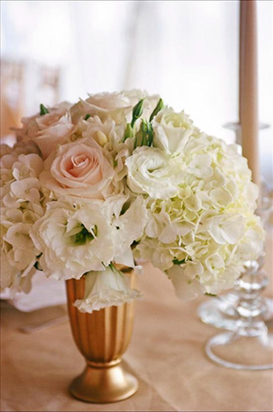 "CLASSIC TOUCH: Ashley says she wanted the décor to paint a ""traditional and timeless"" picture of the day. ""I chose to do all white flowers and champagne and gold accents,"" she says."