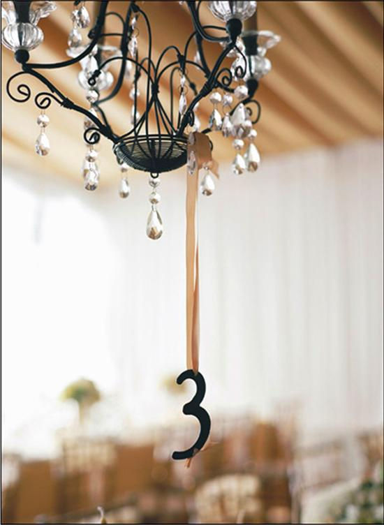 DANGLING DIGITS: Hanging table numbers were easy to spot and filled the air between the chandeliers and table settings.