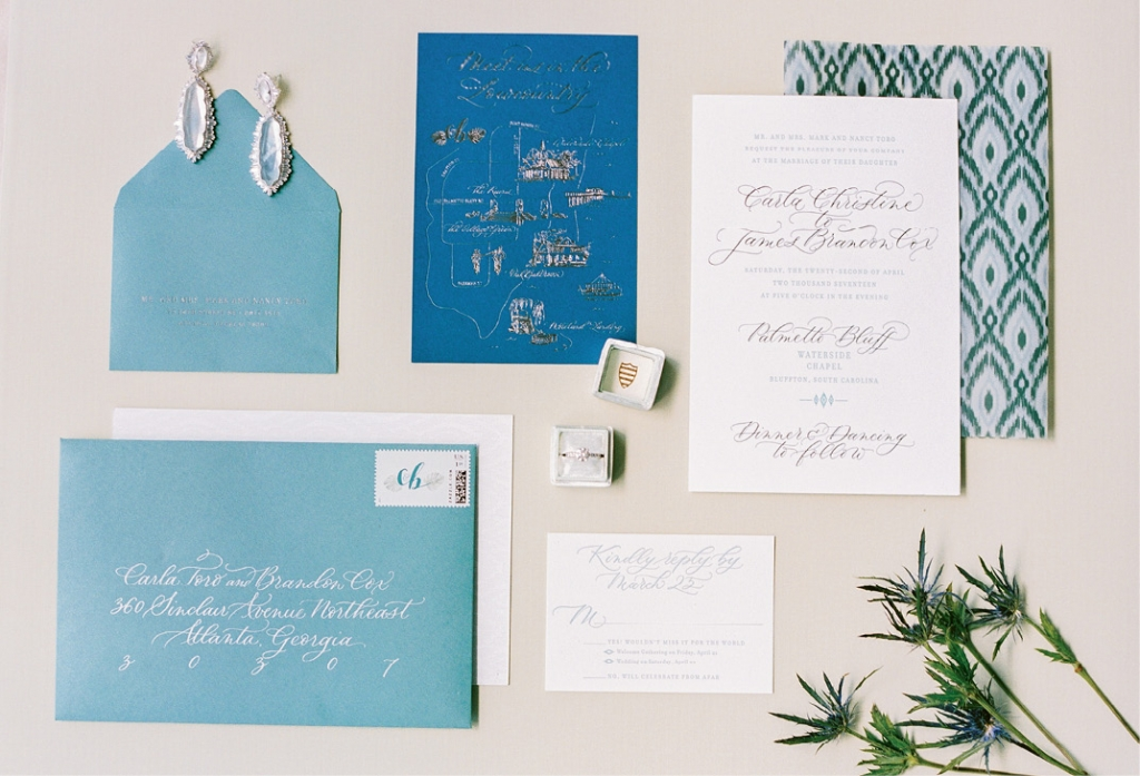 The couple's stationery suite included letterpress invitations, a custom gilded map, ikat patterns, hand-calligraphed addressing, and (not pictured) a watercolor of the chapel where they exchanged vows.