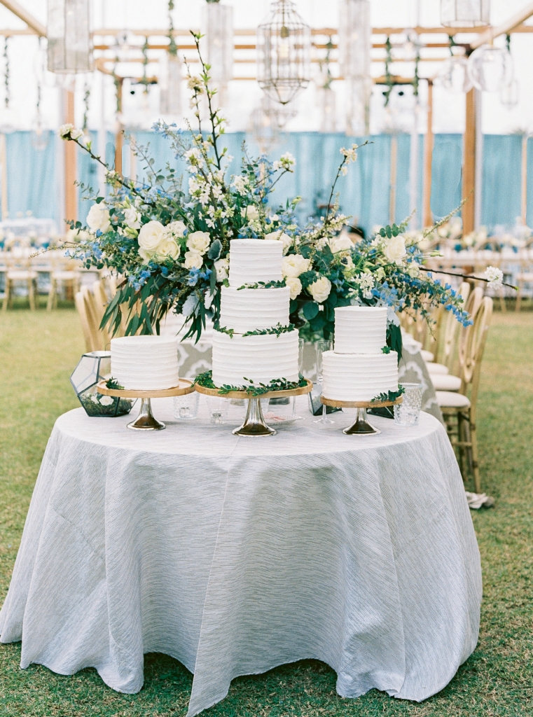 Carla and Brandon's cakes were a smorgasbord of their favorite flavors like cookies and cream, caramel, vanilla, chocolate, and more. To contrast with the melange, each was iced in simple white frosting.