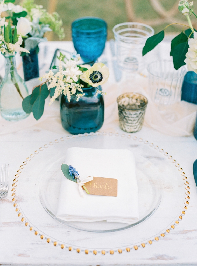 Gilded glass chargers add a dash of elegance to any place setting. Calligraphing an otherwise simple place card like this one transforms it into something sophisticated