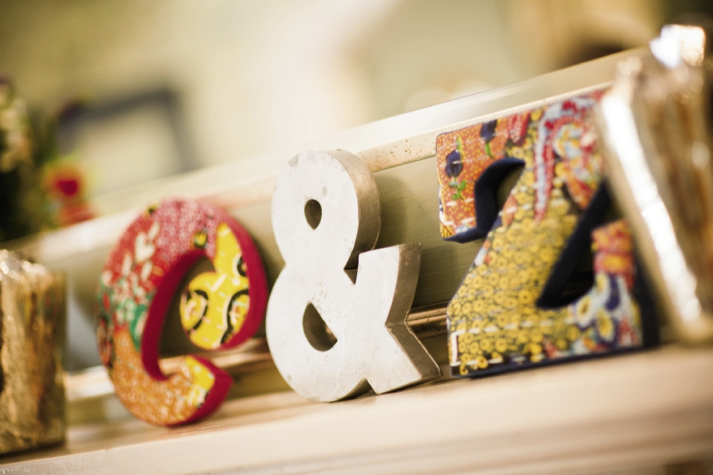 "EASY AS ABC: Fabric-covered letters (""C & Z"") from Anthropologie added to the mishmash of colors and prints."