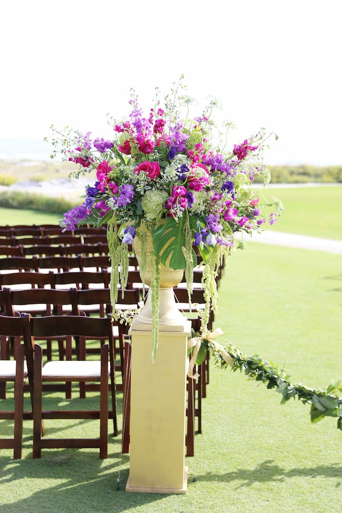 Wedding and floral design by A Charleston Bride. Chairs from EventWorks. Image by Lindsay Collette Photography.