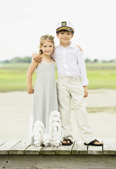 In a flowy maxi dress and floral wreath, flower girl Abby exuded hippie-chic. As an ode to the island (accessible only by boat), ring bearer Dominick upgraded his khakis and leather flip-flops with a captain's hat.