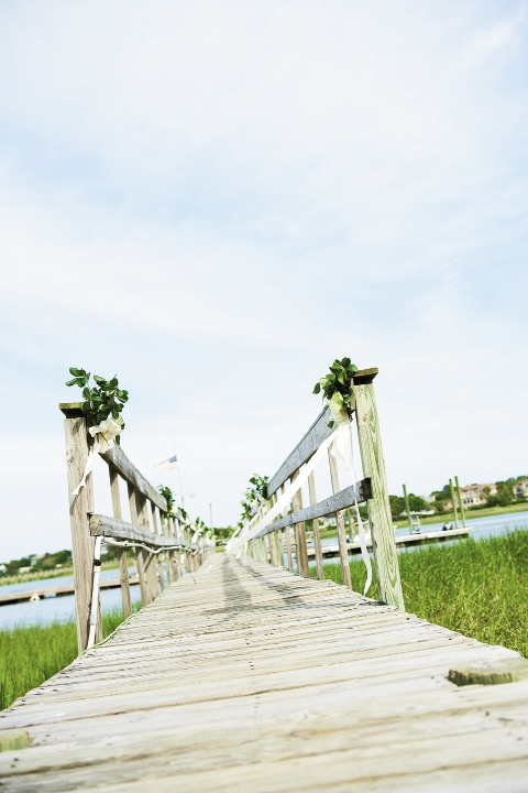 Guests arrived on the island via a wooden dock lined with magnolia bunches.