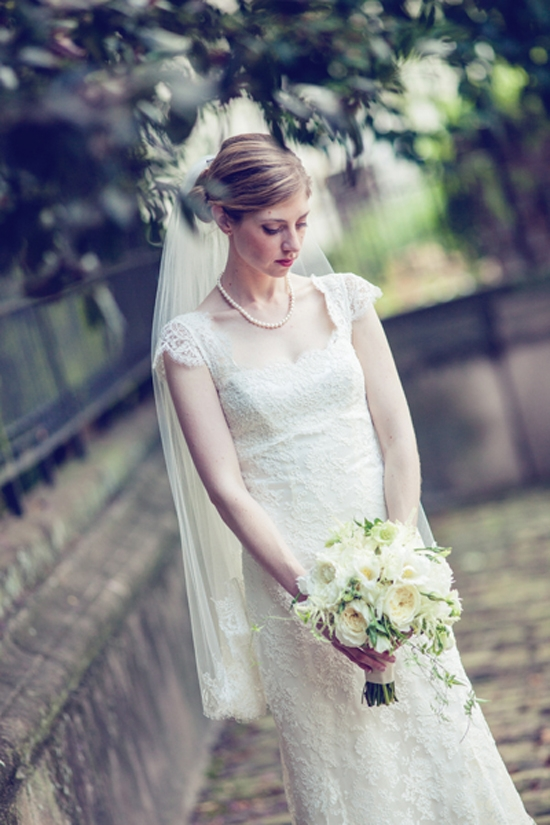 MONOCHROME: Kate's bouquet of creamy white garden roses paired perfectly with her ivory lace gown.