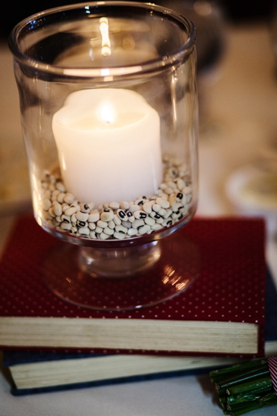 "GOOD FORTUNE: A sign of luck in the South, black eyed peas formed the base for candles nestled in hurricane jars. ""It was a pleasant surprise to my husband's family who is originally from Portugal as black eyed peas are also part of their regional cuisine,"" says Kate."