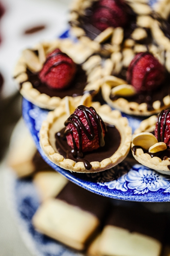 SWEET TREAT: When the bride is a pastry chef, cake just isn't enough; cue these strawberry and chocolate tartlets.