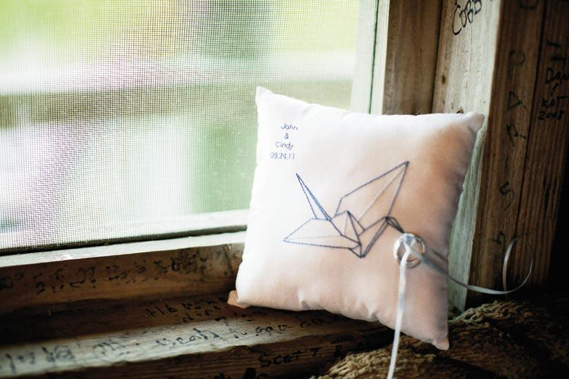 PILLOW TALK:  Cindy's matron of  honor designed and stitched the ring bearer's pillow; in lieu of a flower basket, the flower girl carried chains of paper cranes.