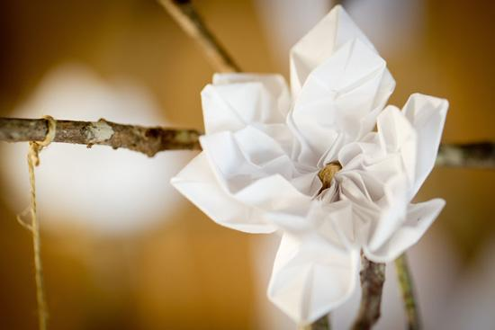 FLOWER POWER: Cindy tied origami flowers and cranes from recycled paper to branches, which were featured throughout the wedding and reception.