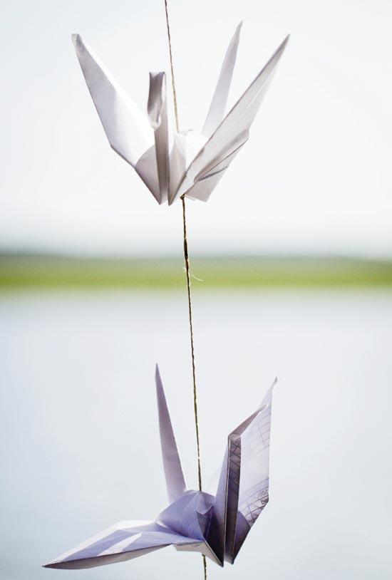 HANGING AROUND: Cindy made origami cranes—a symbol of longevity, loyalty, and happiness in Japanese culture—from recycled paper.