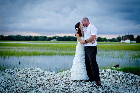 AW, SHUCKS: The couple, pictured here on a hill of oyster shells, kept their attire within budget: Cindy wore a gown from David's Bridal, while John donned a Biton shirt and brown pants found at JCPenney.
