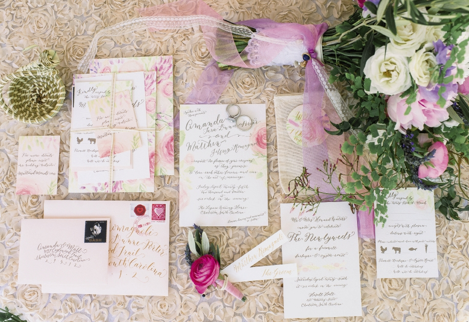 Original, hand-painted watercolor flowers were paired with gold script throughout the invitation suite and event signage.