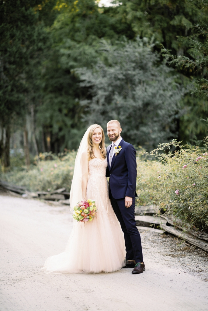 FASHION FORWARD: Lindsay sparkled in a pale pink beaded Monique Lhuillier gown (available in Charleston through Maddison Row), while Brian opted for a  slim-fitting Paul Smith Mainline suit in navy blue, brightened  with a Billy Ball boutonniere.