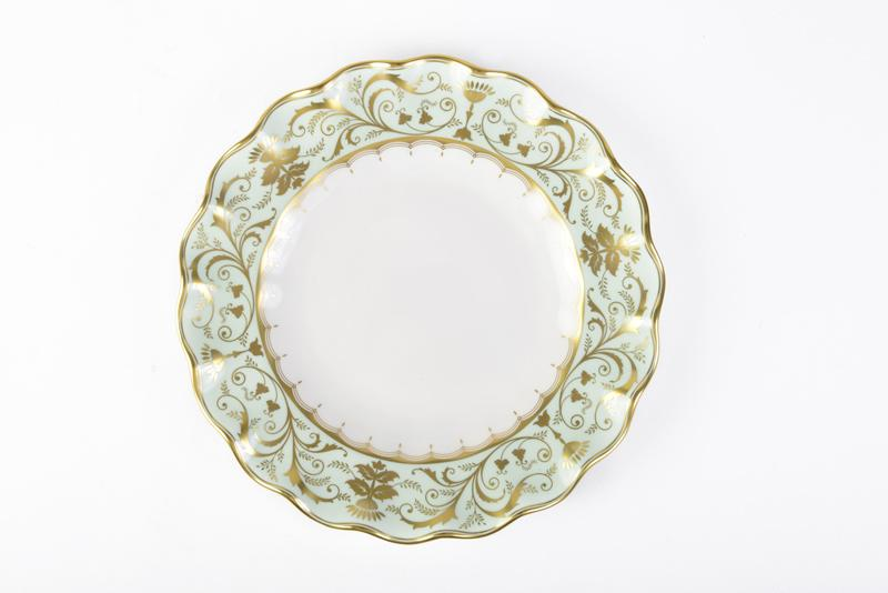 "Royal Crown Derbys' ""Darley Abbey"" Dessert Plate. Made of fine bone china, the glimmering gold and scalloped detailing on this dinnerware impart English regency style. The Boutique, $285 (8.5-inch plate)"