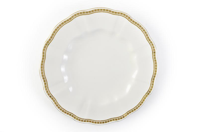 "Royal Crown Derby's ""Carlton Gold"" Dinner Plate. Subtle sophistication is the name of the game with with this pattern that ups the elegant factor on any table. Vieuxtemps, $105 (10-inch plate)"