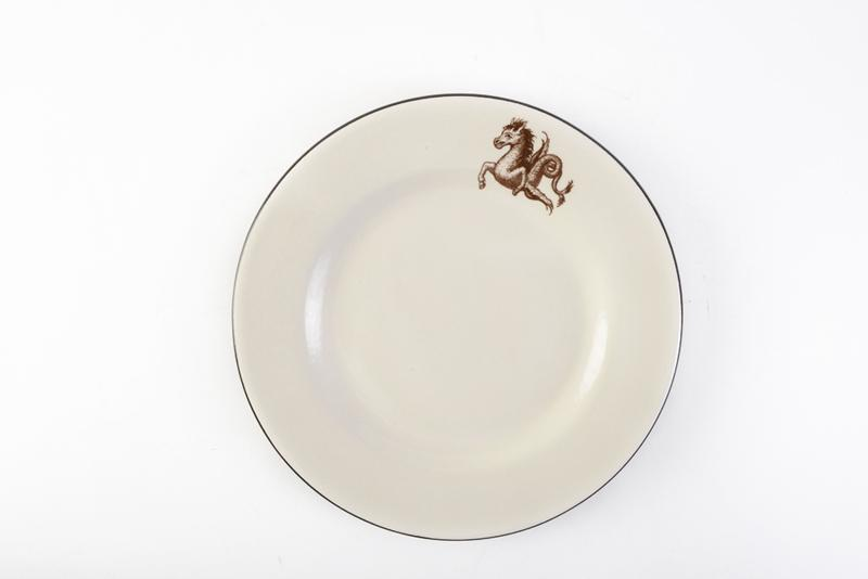 Ceramiche Rometti's Dinner Plate. Handmade in Italy, the porcelain tableware features either classic dolphins, a seahorse, the della Porta family crest (owners of The Hidden Countship), or your own custom-made coat of arms. The Hidden Countship, $32 (11.375-inch plate)