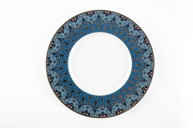 Dhara Peacock Dessert Plate. Embellished with platinum details, this pattern pulls inspiration from Persia and India. Jeffrey Bannon, $90 (9.5-inch plate)