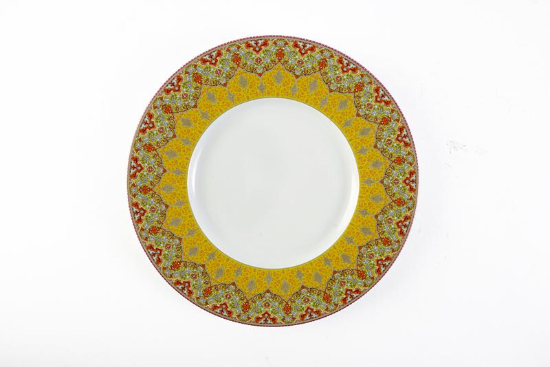 Dhara Red Dessert Plate. The intense red and gold hues, inspired by India, along with the perfect gold matte finish, delivers vibrant life to your setting. Jeffrey Bannon, $85 (9.5-inch plate)