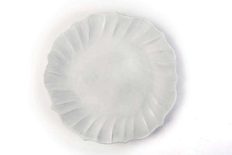 Vietri Incanto Ruffle Dinner Plate. Made of terra marrone, the simplicity of this white dinnerware allows for an easy mix-and-match with other colors and styles. Open House, $46 (12-inch plate)