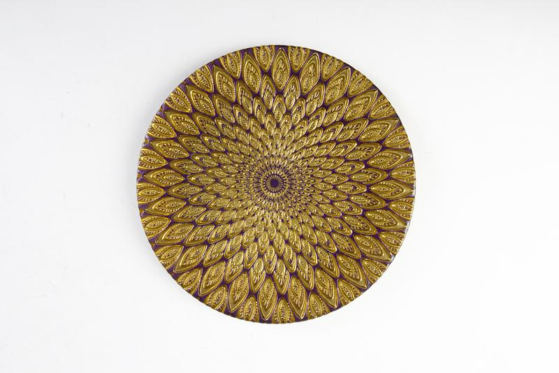 Vietri Peacock Glass Salad Plate. Italian designed, this glass plate mesmerizes with its vivid purple and gold color scheme. Gwynn's of Mount Pleasant, $35 (8.5-inch plate)