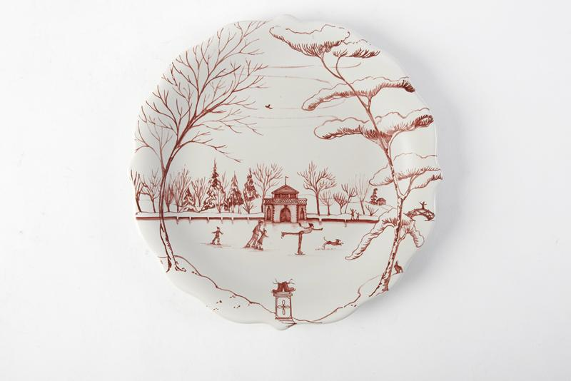 "Juliska's ""Country Estate"" Dessert Plate in Ruby. The scalloped edges and snowy boathouse scene on this plate make it the perfect go-to for festive décor. GDC Home, $98 (8.5-inch plate)"