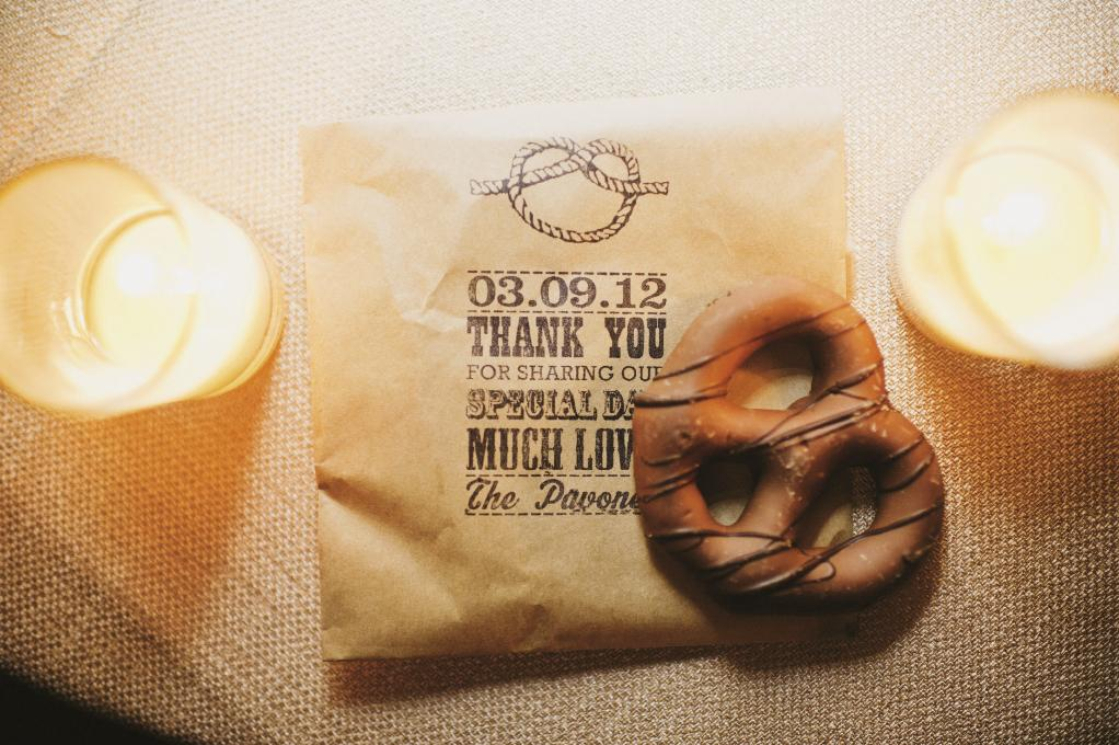 STAMP IT OUT: The wedding's tie-the-knot motif appeared on pretzel favor bags with custom, inked on text thanks to Simon's Stamps.