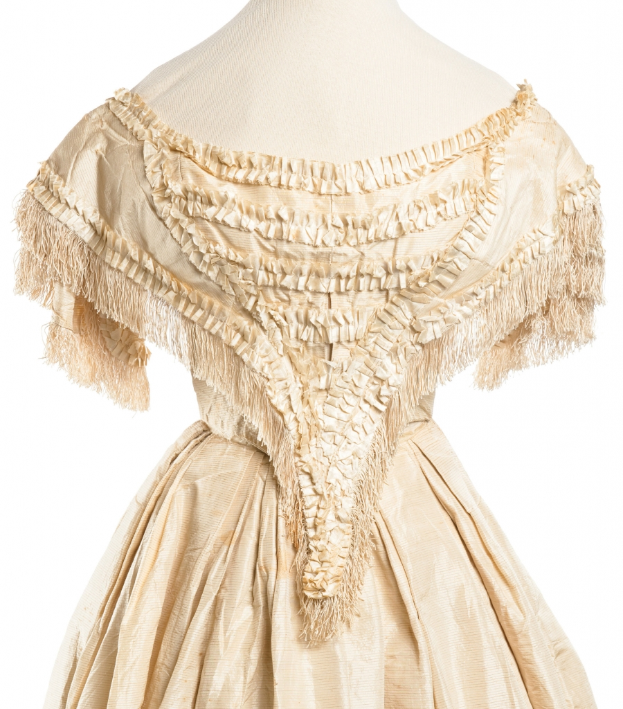 Louisa Jane Dearing, 1859: Paired with a billowing ball gown skirt, this silk taffeta top—complete with a scooped neckline, fringe, box pleating, and a laced-up corset—delivered the waist-cinching silhouette that was oh-so in vogue when bride Louisa Jane Dearing wed Charleston native Henry Edmondston on December 28, 1859, in Augusta, Georgia.