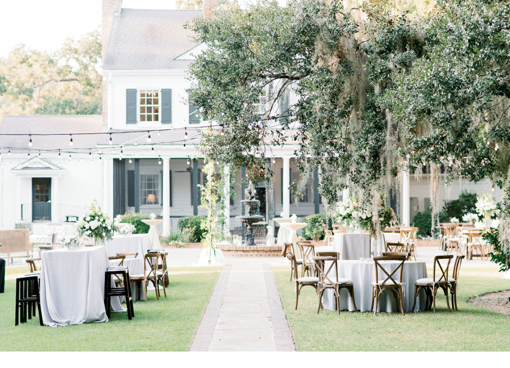 The ceremony took place amidst the Legare Waring House's Avenue of Oaks; from there, guests strolled to the reception, which was held in the shadow of the manse.  <i>Image Aaron & Jillian Photography</i>