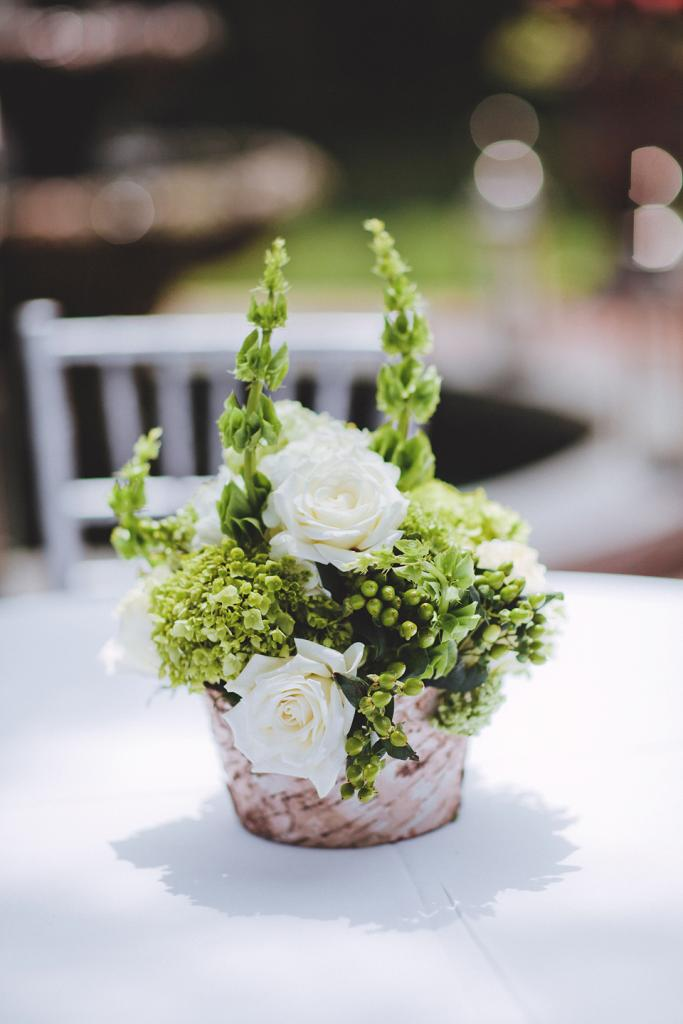 UNDERSTATED STYLE: Loluma tucked the fresh florals into small rustic pots.