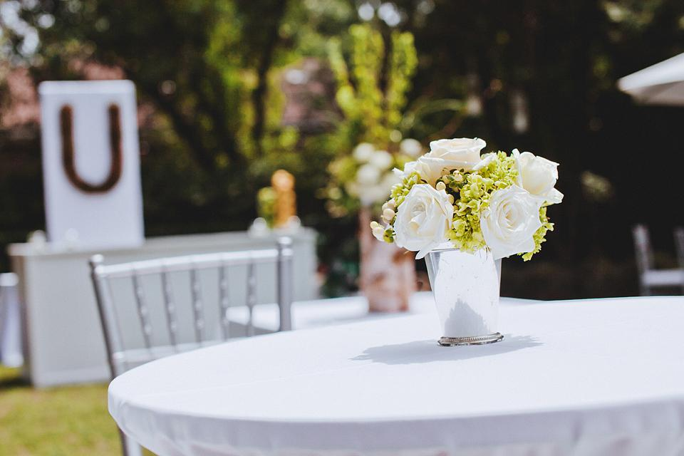 STUNNING SET: Silver vessels matched cocktail tables' Chiavari chairs.