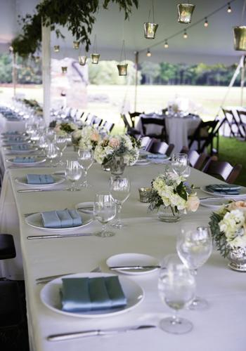 DIVE IN: Ivory tablecloths from BBJ Linen,  silver-blue napkins, and mercury glass gave the sit-down Southern supper a sense of casual elegance.
