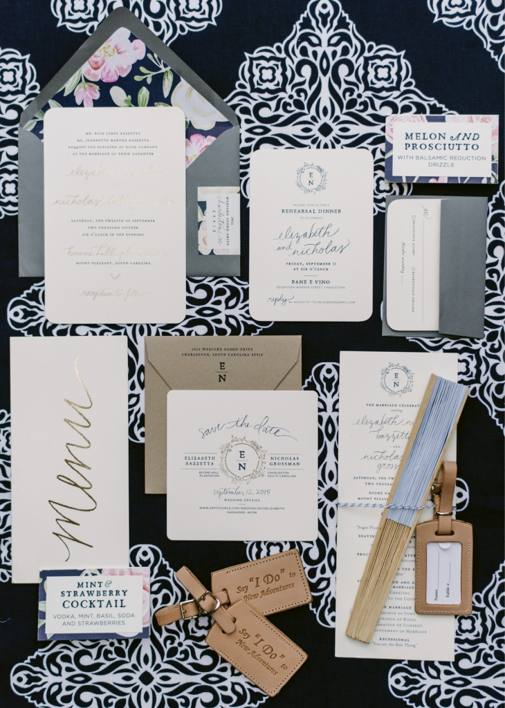 "Studio R concocted a suite of paper goods in the couple's navy, blush, and gold palette. Custom leather luggage tags stamped with ""Say 'I do' to new adventure"" were used for place cards and gifted as favors. (Photograph by Sean Money + Elizabeth Fay)"