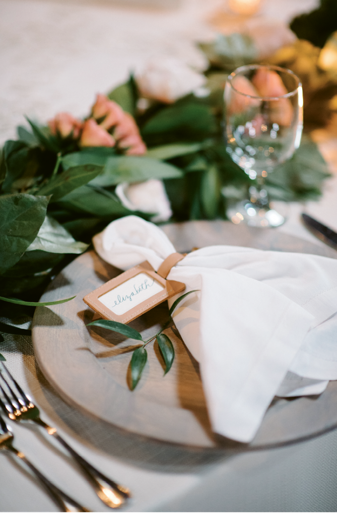 "Custom leather luggage tags stamped with ""Say 'I do' to new adventure"" were used for place cards and gifted as favors. (Photograph by Sean Money + Elizabeth Fay)"