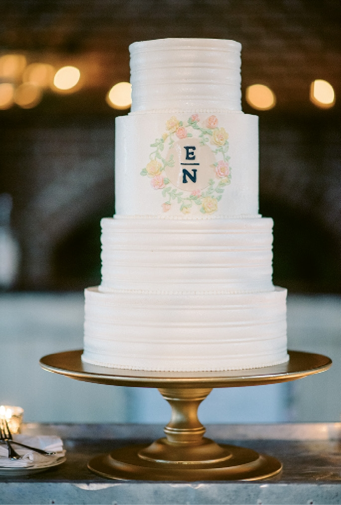The cake by Ashley Bakery sported a monogram that mimicked that on the invitations. (Photograph by Sean Money + Elizabeth Fay)