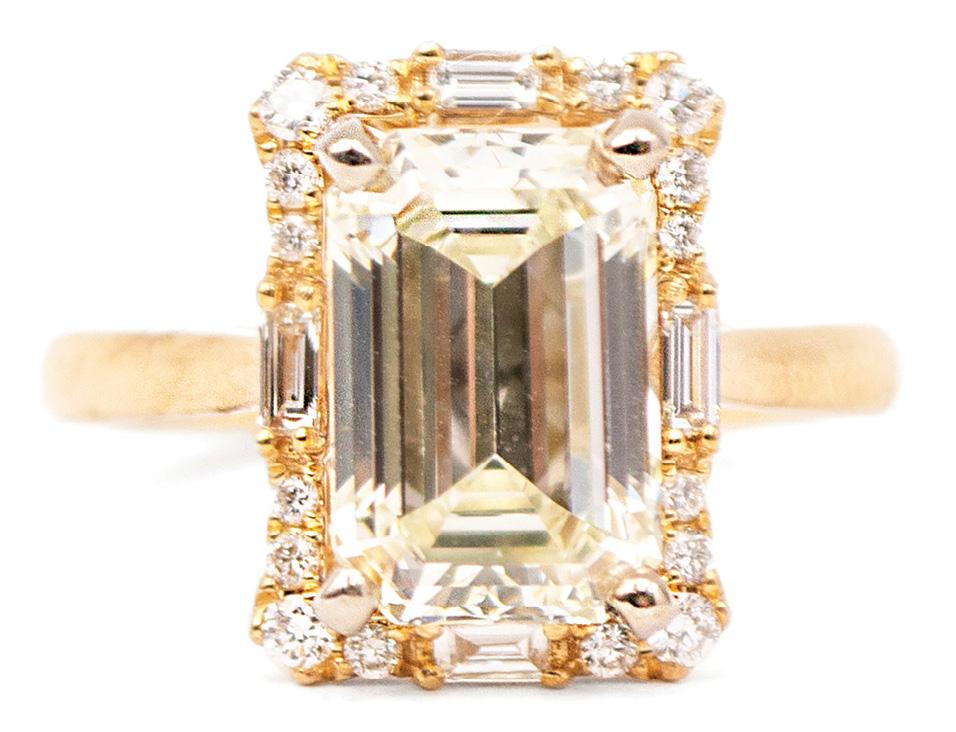 14K yellow gold ring with an emerald-cut diamond (3.32 cts.) surrounded by baguette and round brilliant diamonds (.35 total cts.) from Sandler's Diamonds & Time ($24,898)