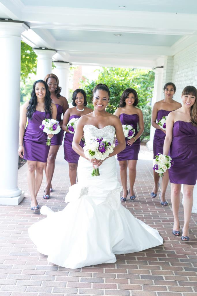 Bridal gown by Victor Harper. Florals by OK Florist. Photograph by Dana Cubbage Weddings at the Daniel Island Club.