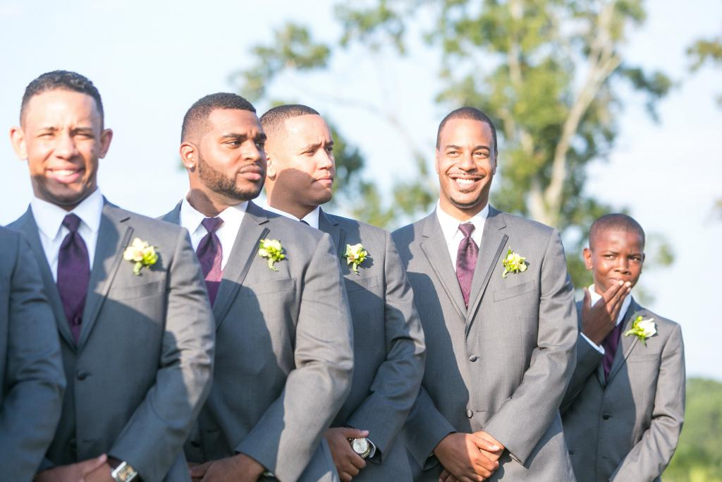 Groomsmen attire from Charleston Tuxedo. Boutonnieres by OK Florist. Photograph by Dana Cubbage Weddings at the Daniel Island Club.