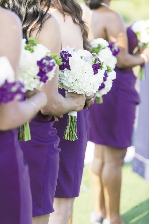 PALETTE PLAY: Bridesmaids carried white bouquets of hydrangeas and roses with sprigs of purple stock.