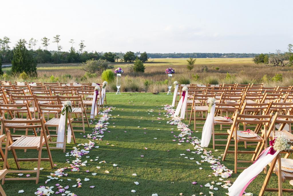 Wedding design by Karen Porreca of Simply Eventful Charleston. Florals by OK Florist. Rentals by EventWorks. Photograph by Dana Cubbage Weddings at the Daniel Island Club.